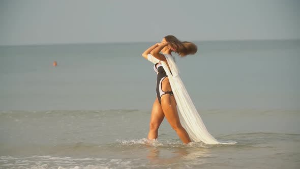 Cover Image for Girl Walks By the Sea Near the Shore