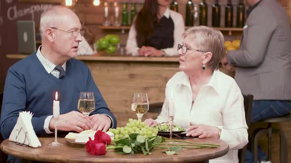 Old Age Couple on a Romantic Date in a Vintage Restaurant