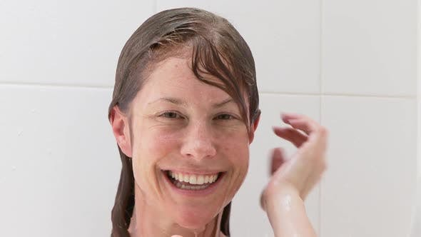 Thumbnail for Portrait of woman washing in shower