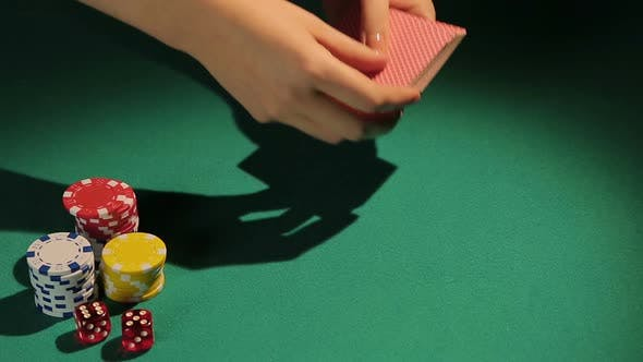 Thumbnail for Female Hands Dealing Cards to Poker Player
