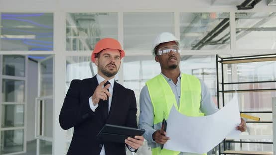Main Manager in Hardhat Walking with Professional Engineer or Builder in Helmet, Protective Glasses