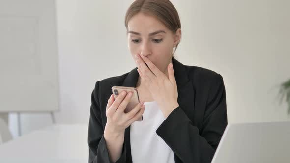 Thumbnail for Close up of Young Businesswoman in Shock Using Smartphone