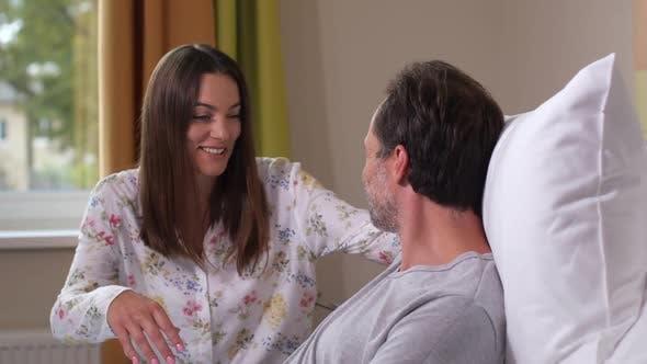 Thumbnail for Happy Woman Hugging Sick Husband During Visit