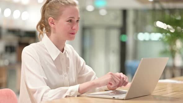 Thumbnail for Cheerful Young Businesswoman Doing Video Chat on Laptop