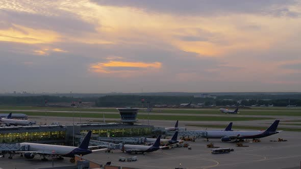 Thumbnail for - Airport View with Airplanes Boarding and Taking Off