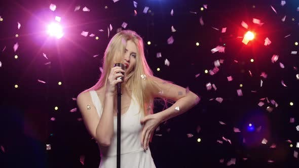 Thumbnail for Girl Singing and Dancing with Retro Microphone Strobe Lighting Effect