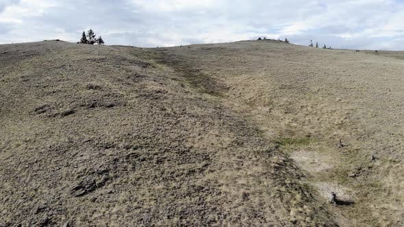 A Drone Flies Over the Ridge, Desert or Steppe Landscape