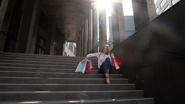 Thumbnail for Cheerful Girl Walking From Centre Mall with Shopping Bags, Happy with Purchase on Black Friday