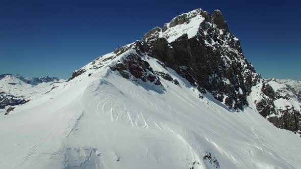 Thumbnail for Flying over Snow Mountain Landscape