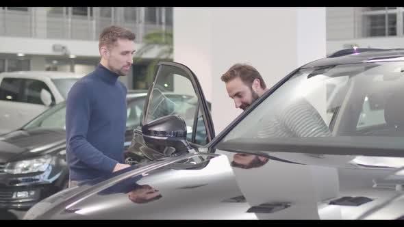 Thumbnail for Male Caucasian Car Dealer Opening Car Door, Adult Man Sitting Into Salon