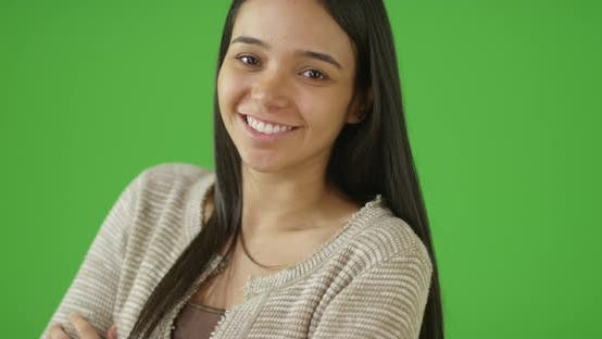 Thumbnail for A young woman smiles at the camera on green screen