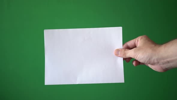 Thumbnail for Man Holding Paper Sheet Hand Isolated On Chroma Key Green Screen Background