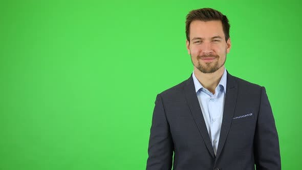 Thumbnail for A Businessman Smiles at the Camera, Then Walks Away, Leaving the Frame on the Left - Green Screen