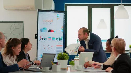 Nervous Businessman Quarrelling in Coworking Having Conflict at Workplace