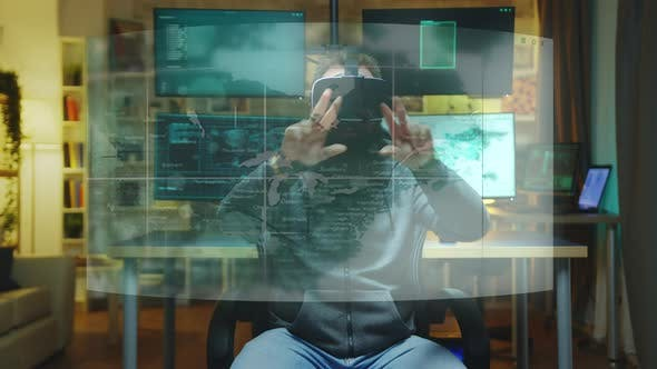 Hacker Wearing VR Headset and Working with AR Holograms