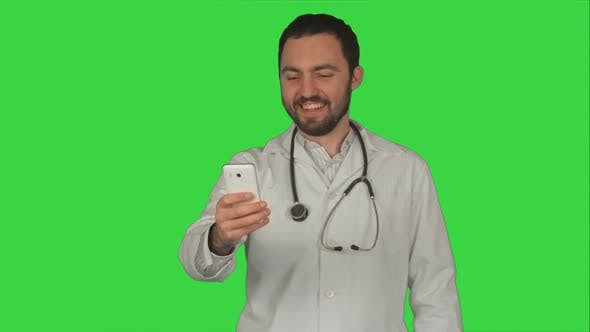 Thumbnail for Doctor or Medic Taking a Selfie with Front Camera of Smartphone on a Green Screen, Chroma Key