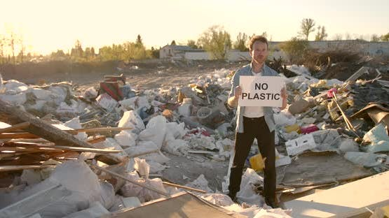 Young Man Activist Holding Poster with Inscription Against Pollution