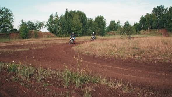 Motorcyclists Racing on Off-Road Track