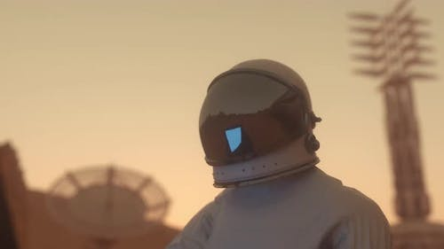 Astronaut Works on His Science Laptop in a Space Colony on One of the Planets
