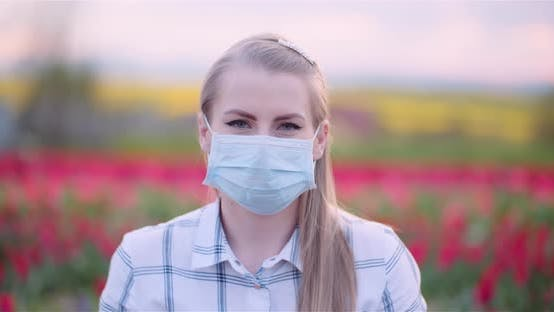 Thumbnail for Woman Wearing Protective Mask Removing It and Taking a Deep Fresh Breath