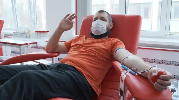 Thumbnail for Blood Donor Makes Okay Gesture. Mature Man with Beard Showing Ok Sign and Looking at the Camera