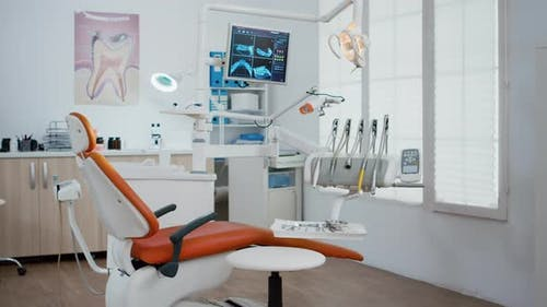 Interior of Modern Equipment Oral Office with Teeth x Ray on Monitors