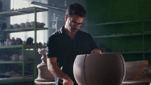 Craftsman Creating Clay Bowl in Studio