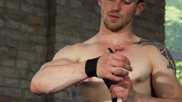 Thumbnail for Muscular Male Fighter Strapping His Hands Before the Fight