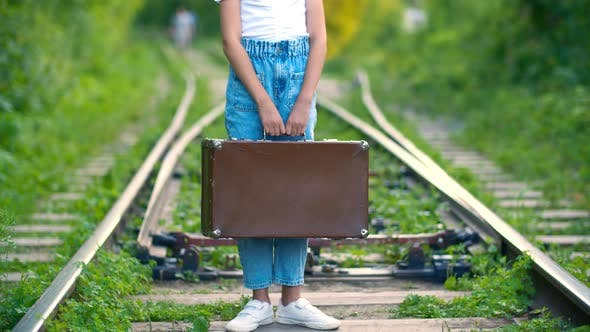 Thumbnail for Young Woman with Retro Suitcase Standing in Railway at Summer. Traveling Girl Holding in Hands