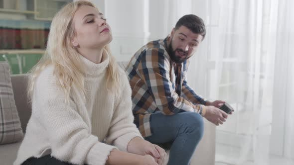 Thumbnail for Angry Bearded Caucasian Guy Shouting at Blond Woman From the Background. Husband Blaming Cheating