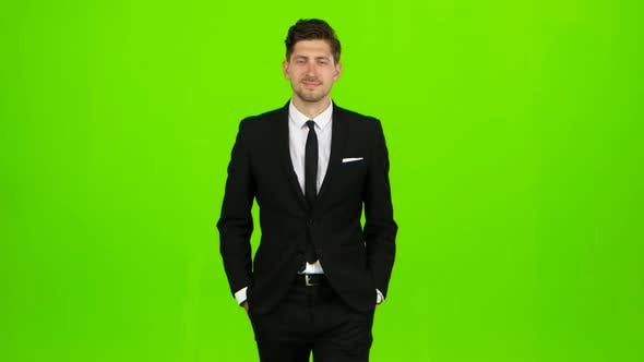 Thumbnail for Businessman Is Going To a Meeting and Waving Greetings. Green Screen