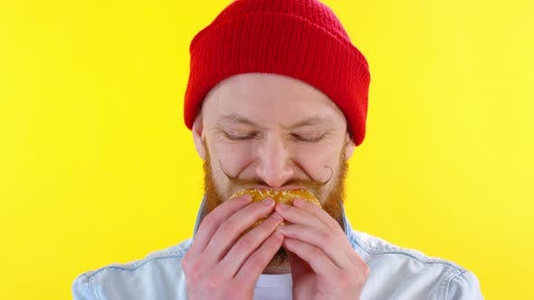 Thumbnail for Face of Bearded Man Eating Sandwich