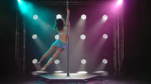 Beautiful Slim Woman with Pylon. Female Pole Dancer Woman Dancing on a Pole. Slow Motion.