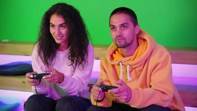 Gamers are Playing Video Games Using Joysticks