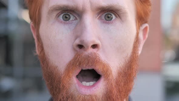 Thumbnail for Close up of Shocked Face of Beard Young Man Face