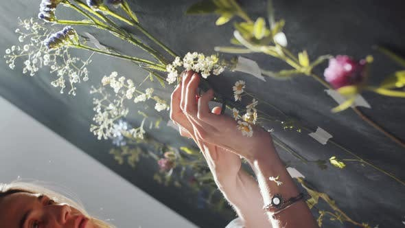 Thumbnail for Female Florist Decorating Wall with Wild Flowers