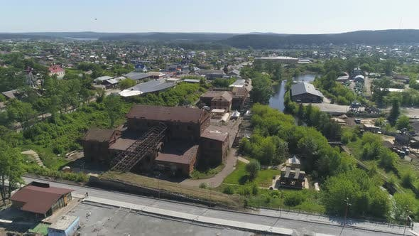Aerial view of old red brick factory with an iron roof on the outskirts of the city 11