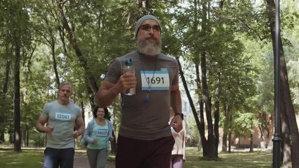 Senior Sporty People Running in Park