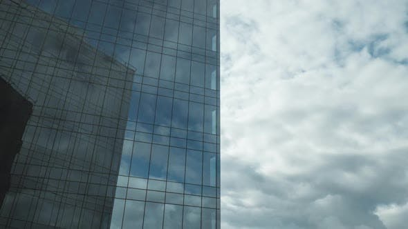 Thumbnail for Timelapse of Clouds Moving and Reflecting in Glassy Skyscraper
