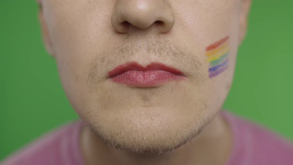 Cover Image for Bearded Man with Painted Lips Kiss on the Camera. LGBT Community. Transsexual
