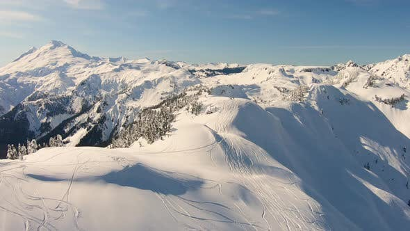 Cover Image for Mt Baker Ski Area Shuksan Arm Aerial Shot Flying Over Skiers Snowboarders Hiking For Powder