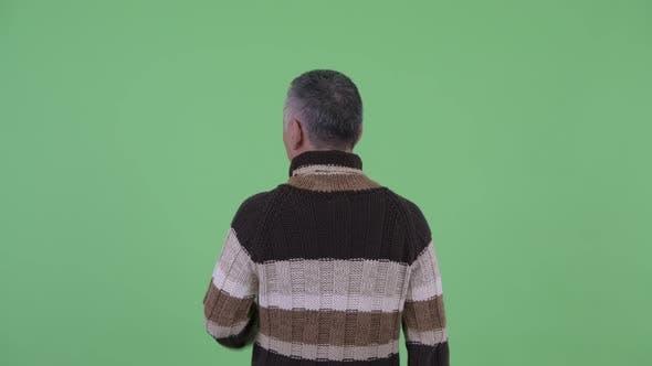 Thumbnail for Rear View of Mature Japanese Man Touching Something