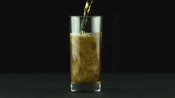 Thumbnail for Cola Is Poured Into Glass Full of Bubbles and Foam Isolated on Black Background