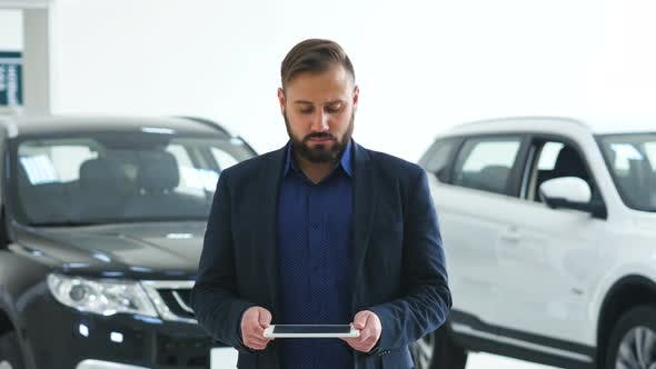 Thumbnail for Image for Graphic Implements, Man in Business Suit with Future Technology Screen and Modern