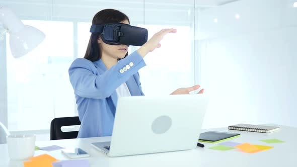 Thumbnail for Wearing Virtual Reality Glasses in Office. Using VR Goggles Headset