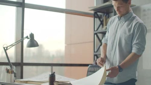 Hipster Engineer Works with Blueprint