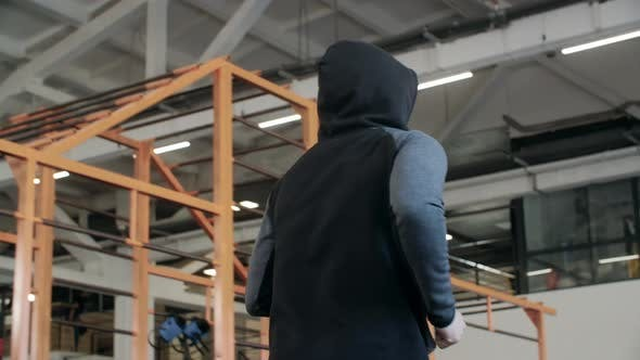 Male Unrecognizable Jogger in Hoodie Running in Fitness Club