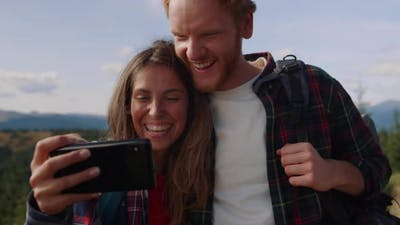 Couple Watching Funny Video on Mobile Phone