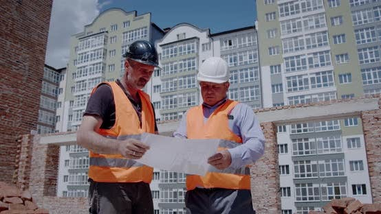 Thumbnail for Construction Manager and Engineer Working on Building Site, Construction Workers Look at the