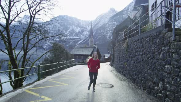 Cover Image for Young woman running on the streets of Hallstatt